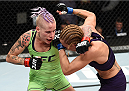 LAS VEGAS, NEVADA - DECEMBER 12: (L-R) Bec Rawlings exchanges punches with Heather Jo Clark in their strawweight fight during The Ultimate Fighter Finale event inside the Pearl concert theater at the Palms Casino Resort on December 12, 2014 in Las Vegas, Nevada. (Photo by Jeff Bottari/Zuffa LLC/Zuffa LLC via Getty Images)