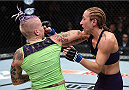 LAS VEGAS, NEVADA - DECEMBER 12: (L-R) Bec Rawlings elbows Heather Jo Clark in their strawweight fight during The Ultimate Fighter Finale event inside the Pearl concert theater at the Palms Casino Resort on December 12, 2014 in Las Vegas, Nevada. (Photo by Jeff Bottari/Zuffa LLC/Zuffa LLC via Getty Images)
