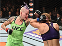 LAS VEGAS, NEVADA - DECEMBER 12: (L-R) Bec Rawlings punches Heather Jo Clark in their strawweight fight during The Ultimate Fighter Finale event inside the Pearl concert theater at the Palms Casino Resort on December 12, 2014 in Las Vegas, Nevada. (Photo by Jeff Bottari/Zuffa LLC/Zuffa LLC via Getty Images)
