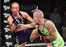 LAS VEGAS, NEVADA - DECEMBER 12: (R-L) Bec Rawlings punches Heather Jo Clark in their strawweight fight during The Ultimate Fighter Finale event inside the Pearl concert theater at the Palms Casino Resort on December 12, 2014 in Las Vegas, Nevada. (Photo by Jeff Bottari/Zuffa LLC/Zuffa LLC via Getty Images)