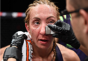LAS VEGAS, NEVADA - DECEMBER 12: Heather Jo Clark gets looked at by the cut man after her fight against Bec Rawlings in their strawweight fight during The Ultimate Fighter Finale event inside the Pearl concert theater at the Palms Casino Resort on December 12, 2014 in Las Vegas, Nevada. (Photo by Jeff Bottari/Zuffa LLC/Zuffa LLC via Getty Images)