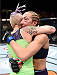 LAS VEGAS, NEVADA - DECEMBER 12: (R-L) Heather Jo Clark hugs Bec Rawlings after their strawweight fight during The Ultimate Fighter Finale event inside the Pearl concert theater at the Palms Casino Resort on December 12, 2014 in Las Vegas, Nevada. (Photo by Jeff Bottari/Zuffa LLC/Zuffa LLC via Getty Images)