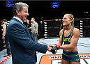 LAS VEGAS, NEVADA - DECEMBER 12:  (R-L) Felice Herrig hakes hands with ring announcer Bruce Buffer after her submission victory over Lisa Ellis in their strawweight fight during The Ultimate Fighter Finale event inside the Pearl concert theater at the Palms Casino Resort on December 12, 2014 in Las Vegas, Nevada. (Photo by Jeff Bottari/Zuffa LLC/Zuffa LLC via Getty Images)