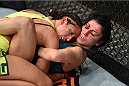 LAS VEGAS, NEVADA - DECEMBER 12:  Jessica Penne (top) pushes Randa Markos against the cage in their strawweight fight during The Ultimate Fighter Finale event inside the Pearl concert theater at the Palms Casino Resort on December 12, 2014 in Las Vegas, Nevada. (Photo by Jeff Bottari/Zuffa LLC/Zuffa LLC via Getty Images)
