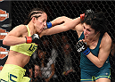 LAS VEGAS, NEVADA - DECEMBER 12:  (L-R) Jessica Penne exchanges punches with Randa Markos in their strawweight fight during The Ultimate Fighter Finale event inside the Pearl concert theater at the Palms Casino Resort on December 12, 2014 in Las Vegas, Nevada. (Photo by Jeff Bottari/Zuffa LLC/Zuffa LLC via Getty Images)