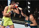 LAS VEGAS, NEVADA - DECEMBER 12:  (R-L) Randa Markos punches Jessica Penne in their strawweight fight during The Ultimate Fighter Finale event inside the Pearl concert theater at the Palms Casino Resort on December 12, 2014 in Las Vegas, Nevada. (Photo by Jeff Bottari/Zuffa LLC/Zuffa LLC via Getty Images)