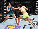 LAS VEGAS, NEVADA - DECEMBER 12:  (R-L) Jessica Penne exchanges punches with Randa Markos in their strawweight fight during The Ultimate Fighter Finale event inside the Pearl concert theater at the Palms Casino Resort on December 12, 2014 in Las Vegas, Nevada. (Photo by Jeff Bottari/Zuffa LLC/Zuffa LLC via Getty Images)