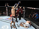 LAS VEGAS, NEVADA - DECEMBER 12: (L-R) Yancy Medeiros celebrates his submission victory over Joe Proctor in their lightweight fight during The Ultimate Fighter Finale event inside the Pearl concert theater at the Palms Casino Resort on December 12, 2014 in Las Vegas, Nevada. (Photo by Jeff Bottari/Zuffa LLC/Zuffa LLC via Getty Images)