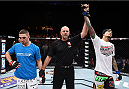 LAS VEGAS, NEVADA - DECEMBER 12: (R-L)Yancy Medeiros celebrates his submission victory over Joe Proctor in their lightweight fight during The Ultimate Fighter Finale event inside the Pearl concert theater at the Palms Casino Resort on December 12, 2014 in Las Vegas, Nevada. (Photo by Jeff Bottari/Zuffa LLC/Zuffa LLC via Getty Images)