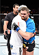 LAS VEGAS, NEVADA - DECEMBER 12: (R-L) Daron Cruickshank and KJ Noons hug after receiving a no contest after an accidental eye poke in their lightweight fight during The Ultimate Fighter Finale event inside the Pearl concert theater at the Palms Casino Resort on December 12, 2014 in Las Vegas, Nevada. (Photo by Jeff Bottari/Zuffa LLC/Zuffa LLC via Getty Images)