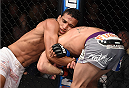 LAS VEGAS, NEVADA - DECEMBER 12:  (L-R) Charles Oliveira attempts to submit Jeremy Stephens in their lightweight fight during The Ultimate Fighter Finale event inside the Pearl concert theater at the Palms Casino Resort on December 12, 2014 in Las Vegas, Nevada. (Photo by Jeff Bottari/Zuffa LLC/Zuffa LLC via Getty Images)
