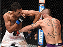 LAS VEGAS, NEVADA - DECEMBER 12: (L-R) Charles Oliveira elbows Jeremy Stephens in their lightweight fight during The Ultimate Fighter Finale event inside the Pearl concert theater at the Palms Casino Resort on December 12, 2014 in Las Vegas, Nevada. (Photo by Jeff Bottari/Zuffa LLC/Zuffa LLC via Getty Images)