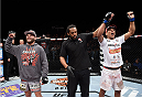 LAS VEGAS, NEVADA - DECEMBER 12: (R-L) Charles Oliveira celebrates his victory over Jeremy Stephens in their lightweight fight during The Ultimate Fighter Finale event inside the Pearl concert theater at the Palms Casino Resort on December 12, 2014 in Las Vegas, Nevada. (Photo by Jeff Bottari/Zuffa LLC/Zuffa LLC via Getty Images)