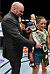 LAS VEGAS, NEVADA - DECEMBER 12: UFC President Dana White presents Carla Esparza with the strawweight championship belt after submitting Rose Namajunas in the third round during The Ultimate Fighter Finale event inside the Pearl concert theater at the Palms Casino Resort on December 12, 2014 in Las Vegas, Nevada. (Photo by Jeff Bottari/Zuffa LLC/Zuffa LLC via Getty Images)