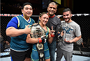 LAS VEGAS, NEVADA - DECEMBER 12: Carla Esparza takes a photo with her team after submitting Rose Namajunas in the third round and becomes the first UFC women's srawwieght champion during The Ultimate Fighter Finale event inside the Pearl concert theater at the Palms Casino Resort on December 12, 2014 in Las Vegas, Nevada. (Photo by Jeff Bottari/Zuffa LLC/Zuffa LLC via Getty Images)
