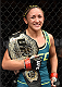 LAS VEGAS, NEVADA - DECEMBER 12: Carla Esparza celebrates her submission victory over Rose Namajunas in the third round and becomes the first UFC women's srawwieght champion during The Ultimate Fighter Finale event inside the Pearl concert theater at the Palms Casino Resort on December 12, 2014 in Las Vegas, Nevada. (Photo by Jeff Bottari/Zuffa LLC/Zuffa LLC via Getty Images)