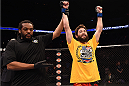 PHOENIX, AZ - DECEMBER 13:  Bryan Barberena celebrates after defeating Joe Ellenberger in their lightweight fight during the UFC Fight Night event at the U.S. Airways Center on December 13, 2014 in Phoenix, Arizona.  (Photo by Josh Hedges/Zuffa LLC/Zuffa LLC via Getty Images)