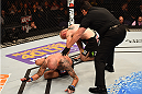 PHOENIX, AZ - DECEMBER 13:  (R-L) Referee  John McCarthy calls a stop to the fight between Joe Riggs and Ben Saunders in their welterweight fight during the UFC Fight Night event at the U.S. Airways Center on December 13, 2014 in Phoenix, Arizona. Ben Saunders won due to injury stoppage from Joe Riggs. (Photo by Josh Hedges/Zuffa LLC/Zuffa LLC via Getty Images)