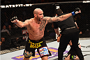 PHOENIX, AZ - DECEMBER 13:  Ben Saunders celebrates after defeating Joe Riggs in their welterweight fight during the UFC Fight Night event at the U.S. Airways Center on December 13, 2014 in Phoenix, Arizona.  (Photo by Josh Hedges/Zuffa LLC/Zuffa LLC via Getty Images)