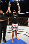 PHOENIX, AZ - DECEMBER 13:  Matt Mitrione celebrates after defeating Gabriel Gonzaga of Brazil in their heavyweight fight during the UFC Fight Night event at the U.S. Airways Center on December 13, 2014 in Phoenix, Arizona.  (Photo by Josh Hedges/Zuffa LLC/Zuffa LLC via Getty Images)