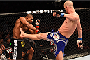 PHOENIX, AZ - DECEMBER 13:  (R-L) Stefan Struve of the Netherlands kicks Alistair Overeem of the Netherlands in their heavyweight fight during the UFC Fight Night event at the U.S. Airways Center on December 13, 2014 in Phoenix, Arizona.  (Photo by Josh Hedges/Zuffa LLC/Zuffa LLC via Getty Images)