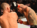 PHOENIX, AZ - DECEMBER 13:  (R-L) Rafael dos Anjos of Brazil punches Nate Diaz in their lightweight fight during the UFC Fight Night event at the U.S. Airways Center on December 13, 2014 in Phoenix, Arizona.  (Photo by Josh Hedges/Zuffa LLC/Zuffa LLC via Getty Images)