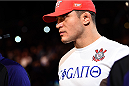 PHOENIX, AZ - DECEMBER 13:  Junior Dos Santos of Brazil enters the arena before facing Stipe Miocic in their heavyweight fight during the UFC Fight Night event at the U.S. Airways Center on December 13, 2014 in Phoenix, Arizona.  (Photo by Josh Hedges/Zuffa LLC/Zuffa LLC via Getty Images)
