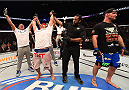 PHOENIX, AZ - DECEMBER 13:  Junior dos Santos of Brazil (L) celebrates after defeating Stipe Miocic by unanimous decision after their heavyweight fight during the UFC Fight Night event at the U.S. Airways Center on December 13, 2014 in Phoenix, Arizona.  (Photo by Josh Hedges/Zuffa LLC/Zuffa LLC via Getty Images)