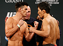 LAS VEGAS, NV - SEPTEMBER 26:  (L-R) Opponents Dominick Cruz and Takeya Mizugaki of Japan face off during the UFC 178 weigh-in at the MGM Grand Conference Center on September 26, 2014 in Las Vegas, Nevada. (Photo by Josh Hedges/Zuffa LLC/Zuffa LLC via Getty Images)