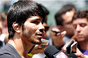 SAO PAULO, BRAZIL - DECEMBER 18:  Erick Silva of Brazil interacts with media after an open training session for fans and media at Allianz Parque on December 18, 2014 in Sao Paulo, Brazil. (Photo by Josh Hedges/Zuffa LLC/Zuffa LLC via Getty Images)