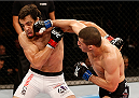 BARUERI, BRAZIL - DECEMBER 20:  (R-L) Rashid Magomedov of Russia punches Elias Silverio of Brazil in their lightweight fight during the UFC Fight Night event inside the Ginasio Jose Correa on December 20, 2014 in Barueri, Brazil. (Photo by Josh Hedges/Zuffa LLC/Zuffa LLC via Getty Images)