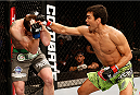 BARUERI, BRAZIL - DECEMBER 20:  (R-L) Lyoto Machida of Brazil punches CB Dollaway of the United States in their middleweight fight during the UFC Fight Night event inside the Ginasio Jose Correa on December 20, 2014 in Barueri, Brazil. (Photo by Josh Hedges/Zuffa LLC/Zuffa LLC via Getty Images)