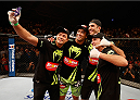 BARUERI, BRAZIL - DECEMBER 20:  Lyoto Machida (second left) of Brazil takes a photo in the Octagon with his team after his TKO victory over CB Dollaway in their middleweight fight during the UFC Fight Night event inside the Ginasio Jose Correa on December 20, 2014 in Barueri, Brazil. (Photo by Josh Hedges/Zuffa LLC/Zuffa LLC via Getty Images)