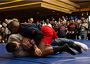LAS VEGAS, NEVADA - DECEMBER 31:  Daniel Cormier (top) wrestles Luke Rockhold during the UFC 182 Open Workouts at the MGM Grand Hotel and Casino on December 31, 2014 in Las Vegas, Nevada. (Photo by Brandon Magnus/Zuffa LLC/Zuffa LLC via Getty Images)