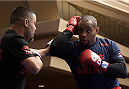 LAS VEGAS, NEVADA - DECEMBER 31:  Daniel Cormier hits pads during the UFC 182 Open Workouts at the MGM Grand Hotel and Casino on December 31, 2014 in Las Vegas, Nevada. (Photo by Brandon Magnus/Zuffa LLC/Zuffa LLC via Getty Images)