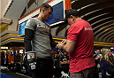 LAS VEGAS, NEVADA - DECEMBER 31:  Myles Jury prepares to hit pads with his trainer during the UFC 182 Open Workouts at the MGM Grand Hotel and Casino on December 31, 2014 in Las Vegas, Nevada. (Photo by Brandon Magnus/Zuffa LLC/Zuffa LLC via Getty Images)