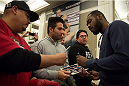 LAS VEGAS, NEVADA - JANUARY 01:  UFC light heavyweight champion Jon Jones signs autographs for fans during the UFC 182 Media Day at the MGM Grand Hotel and Casino on January 1, 2015 in Las Vegas, Nevada. (Photo by Brandon Magnus/Zuffa LLC/Zuffa LLC via Getty Images)