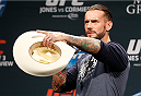 "LAS VEGAS, NV - JANUARY 02:  Phil ""C.M. Punk"" Brooks gives away a signed cowboy hat from Donald ""Cowboy"" Cerrone during a Q&A session before the UFC 182 weigh-in event at the MGM Grand Conference Center on January 2, 2015 in Las Vegas, Nevada. (Photo by Josh Hedges/Zuffa LLC/Zuffa LLC via Getty Images)"