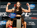 LAS VEGAS, NV - JANUARY 02:  Marion Reneau poses on the scale after weighing in during the UFC 182 weigh-in event at the MGM Grand Conference Center on January 2, 2015 in Las Vegas, Nevada. (Photo by Josh Hedges/Zuffa LLC/Zuffa LLC via Getty Images)