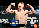LAS VEGAS, NV - JANUARY 02:  Paul Felder poses on the scale after weighing in during the UFC 182 weigh-in event at the MGM Grand Conference Center on January 2, 2015 in Las Vegas, Nevada. (Photo by Josh Hedges/Zuffa LLC/Zuffa LLC via Getty Images)