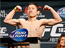 LAS VEGAS, NV - JANUARY 02:  Kyoji Horiguchi of Japan poses on the scale after weighing in during the UFC 182 weigh-in event at the MGM Grand Conference Center on January 2, 2015 in Las Vegas, Nevada. (Photo by Josh Hedges/Zuffa LLC/Zuffa LLC via Getty Images)