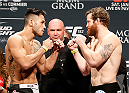 LAS VEGAS, NV - JANUARY 02:  (L-R) Opponents Brad Tavares and Nate Marquardt face off during the UFC 182 weigh-in event at the MGM Grand Conference Center on January 2, 2015 in Las Vegas, Nevada. (Photo by Josh Hedges/Zuffa LLC/Zuffa LLC via Getty Images)