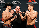 "LAS VEGAS, NV - JANUARY 02:  (L-R) Opponents Donald ""Cowboy"" Cerrone and Myles Jury face off during the UFC 182 weigh-in event at the MGM Grand Conference Center on January 2, 2015 in Las Vegas, Nevada. (Photo by Josh Hedges/Zuffa LLC/Zuffa LLC via Getty Images)"