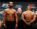 "LAS VEGAS, NV - JANUARY 02:  (L-R) Opponents Jon ""Bones"" Jones and Daniel Cormier refuse to look at each other during the UFC 182 weigh-in event at the MGM Grand Conference Center on January 2, 2015 in Las Vegas, Nevada. (Photo by Josh Hedges/Zuffa LLC/Zuffa LLC via Getty Images)"