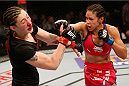 LAS VEGAS, NV - JANUARY 03:  (R-L) Marion Reneau punches Alexis Dufresne in their women's bantamweight bout during the UFC 182 event on January 3, 2015 in Las Vegas, Nevada.  (Photo by Josh Hedges/Zuffa LLC/Zuffa LLC via Getty Images)