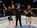 LAS VEGAS, NV - JANUARY 03:  (L-R) Omari Akhmedov celebrates his win over Mats Nilsson in their welterweight bout during the UFC 182 event on January 3, 2015 in Las Vegas, Nevada.  (Photo by Josh Hedges/Zuffa LLC/Zuffa LLC via Getty Images)