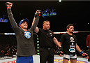 LAS VEGAS, NV - JANUARY 03:  (L-R) Evan Dunham celebrates his win over Rodrigo Damm in their lightweight bout during the UFC 182 event at the MGM Grand Garden Arena on January 3, 2015 in Las Vegas, Nevada.  (Photo by Josh Hedges/Zuffa LLC/Zuffa LLC via Getty Images)
