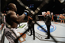 LAS VEGAS, NV - JANUARY 03:  (L-R) Jared Cannonier is introduced by Bruce Buffer before facing Shawn Jordan in their heavyweight bout during the UFC 182 event at the MGM Grand Garden Arena on January 3, 2015 in Las Vegas, Nevada.  (Photo by Josh Hedges/Zuffa LLC/Zuffa LLC via Getty Images)