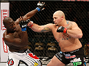 LAS VEGAS, NV - JANUARY 03:  (R-L) Shawn Jordan punches Jared Cannonier in their heavyweight bout during the UFC 182 event at the MGM Grand Garden Arena on January 3, 2015 in Las Vegas, Nevada.  (Photo by Josh Hedges/Zuffa LLC/Zuffa LLC via Getty Images)