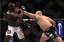 LAS VEGAS, NV - JANUARY 03:  (R) Shawn Jordan punches Jared Cannonier in their heavyweight bout during the UFC 182 event at the MGM Grand Garden Arena on January 3, 2015 in Las Vegas, Nevada.  (Photo by Jeff Bottari/Zuffa LLC/Zuffa LLC via Getty Images)